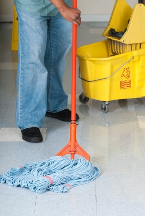 R & S Janitorial Services, Inc. janitor in Lake Peekskill NY mopping floor.